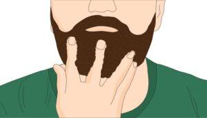 mano che passa l'olio da barba contropelo